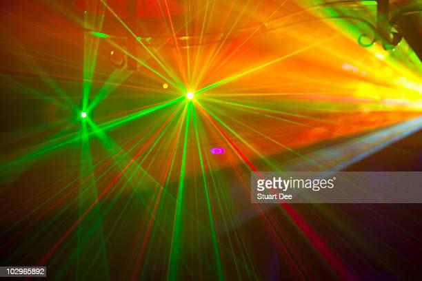 Colored laser lights in nightclub, Paris