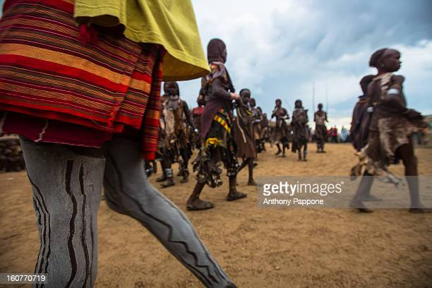 CONTENT] colored legs of a warrior tribe hamer during the bull jumping ceremony Bull jumping ceremony is a rite of passage ceremony for men coming of...