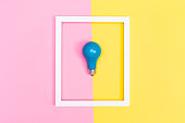 Colored lightbulb on a vibrant duotone background