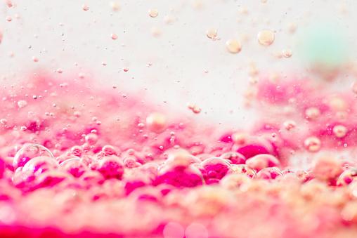 Colored liquids with bubbles, close-up