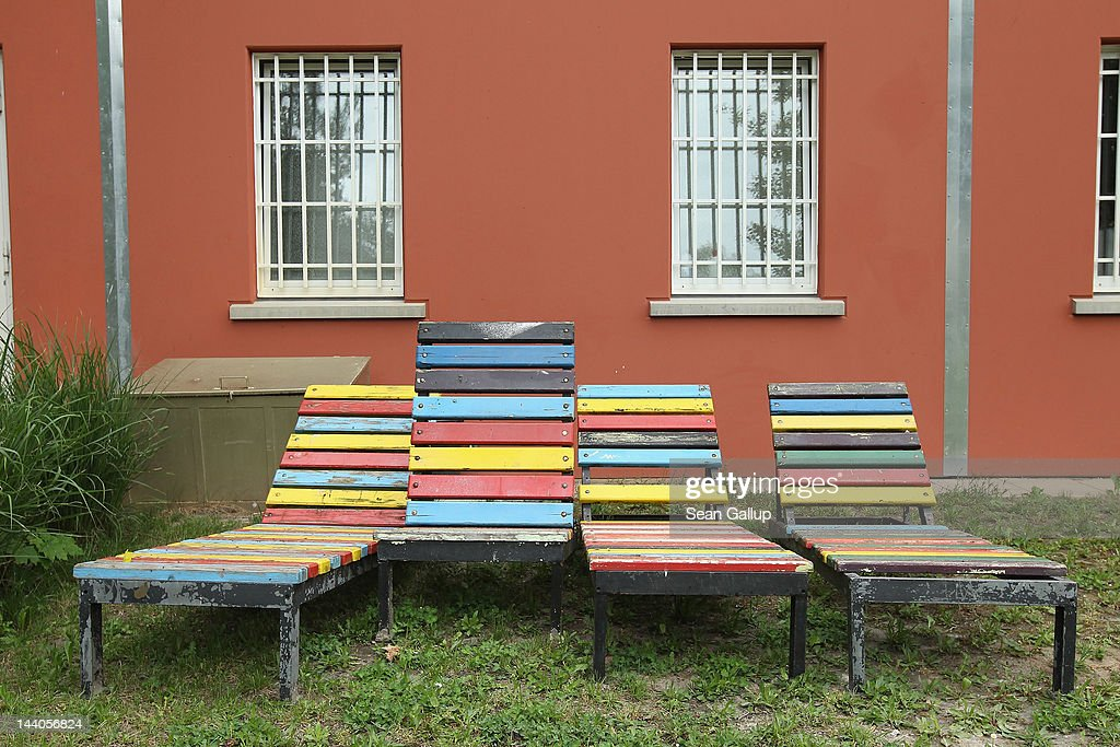 Colored lounge chairs stand in the recreational area next to a cell block at the expanded youth arrest facility in Lichtenrade district on May 9, 2012 in Berlin, Germany. The facility, whose capacity is now nearly doubled, accomodates young men and women first-time offenders for short periods of time with the intent of giving them an impression of what prison is like yet to also give them a second chance at returning to freedom.