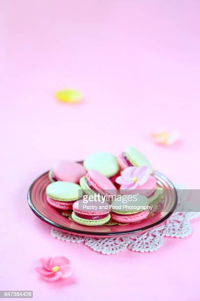 Colored (pink and green) Macarons with Raspberry Cream Filling