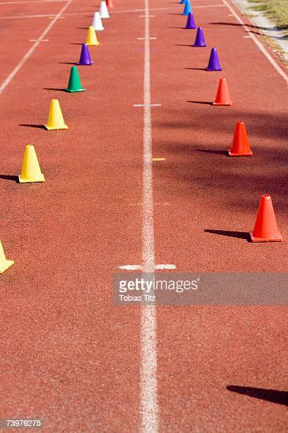 Colored markers on a running track