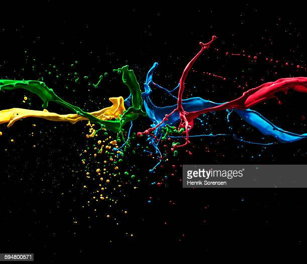 colored paint mixing mid air