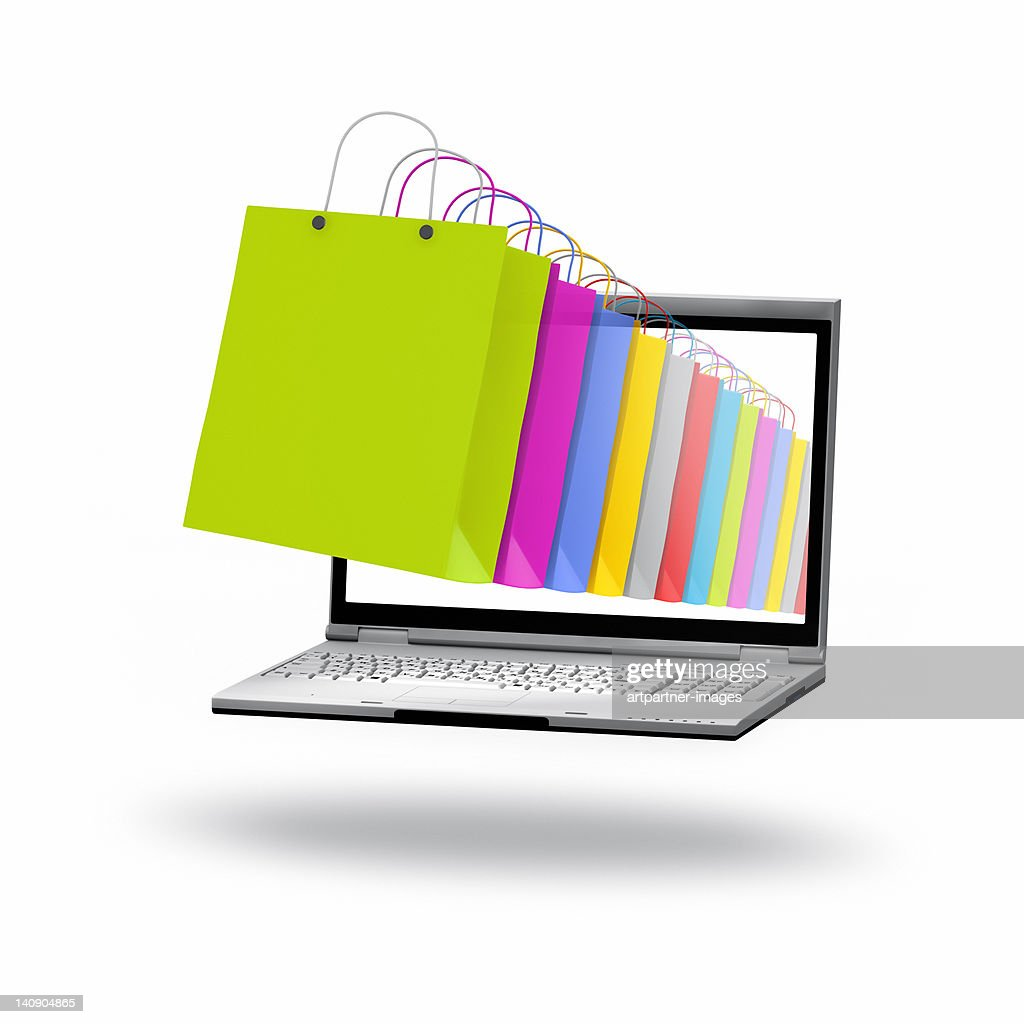 Colored paper bags on a laptop screen : Stock Photo