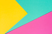 Coloured sheets. Turquoise, pink and yellow conceptual background