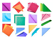 Various colored paper napkins collection. Isolated on white, clipping path included