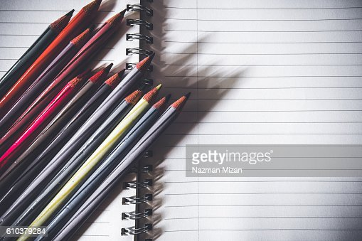 colored pencils arranged on the left hand side diagonally on top of a book stock foto getty images. Black Bedroom Furniture Sets. Home Design Ideas