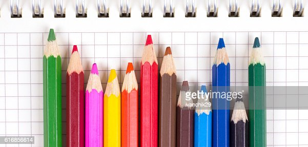Colored pencils on notebooks with rings : Stock Photo