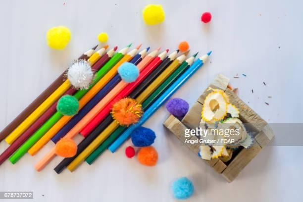 Colored pencils with pom-pom