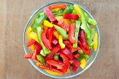 Colored peppers mixed in a glass bowl