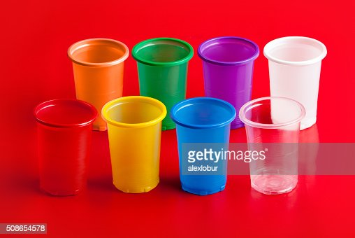 Colored plastic glasses on red background. : Stock Photo