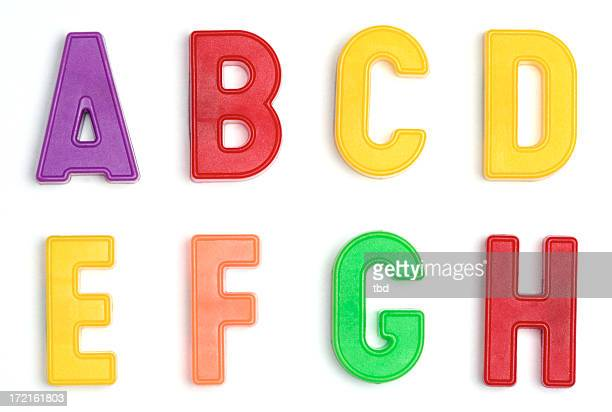 Colored plastic letters A through H