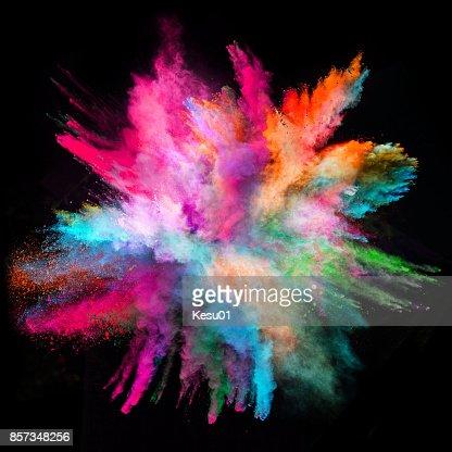 Explosion de poudre colorées sur fond noir : Photo