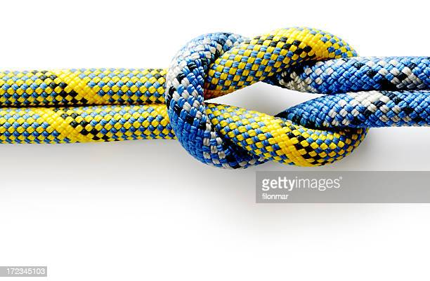 Colored rope tied in a knot on a white background
