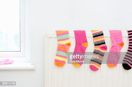 colored socks drying on radiator