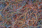 Colored telecommunication cables and wires as background