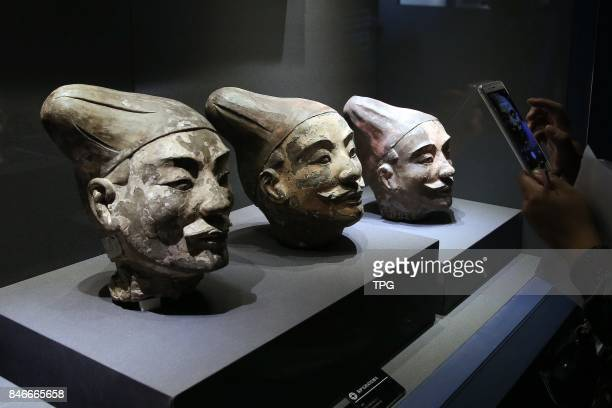 Colored terracotta heads are on display at the Emperor Qinshihuang's Mausoleum Site Museum in Xian City the capital of northwest Chinas Shaanxi...