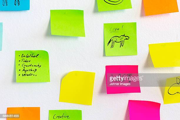 Colorful adhesive cards on white background