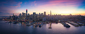 Colorful epic aerial panorama of San Francisco downtown and waterfront at sunset. California, USA.