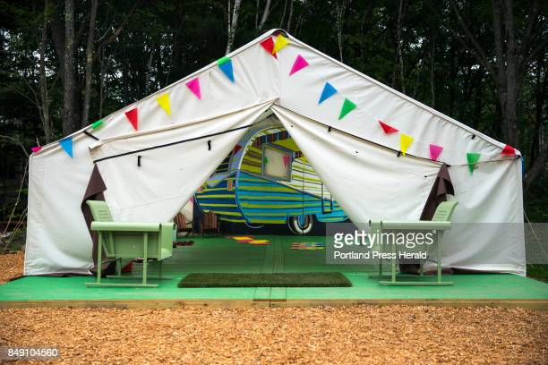 A colorful and inviting tent located within a playground at Sandy Pines Campground is loaded with largescale games like checkers Connect Four and more