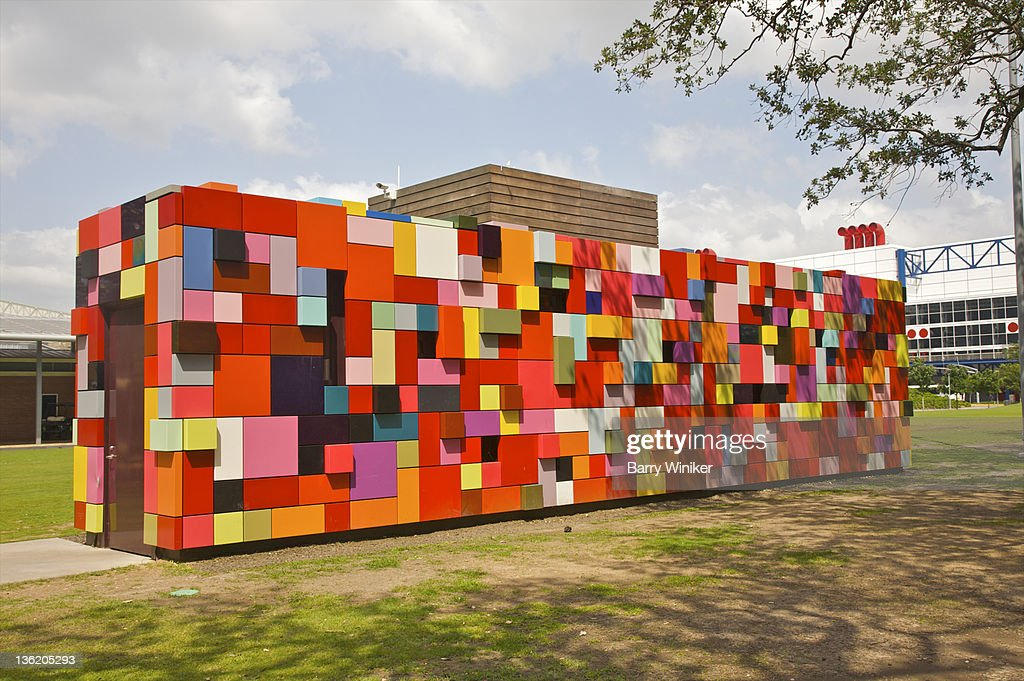 Colorful artwork placed in public park.