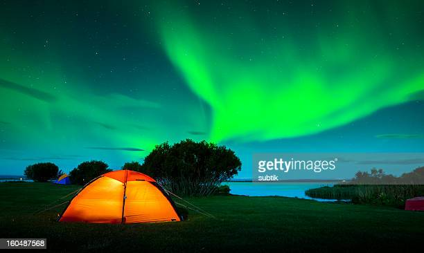 Colorful aurora boreal in green and blue over Iceland