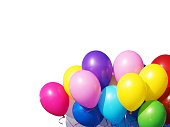 Colorful balloons bunch filled with helium isolated on white background. Bunch of red, blue, white, pink, yellow, green and violet balloons