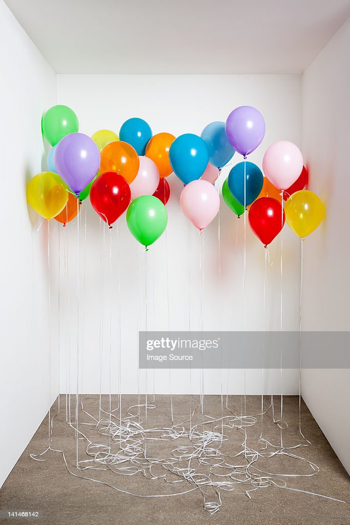 Colorful balloons in a room : Stock Photo