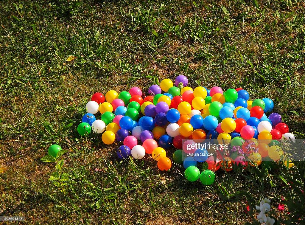 Colorful balls on grass : Foto de stock