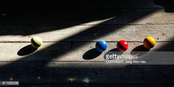 Colorful balls on the wooden floor