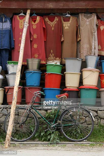 Colorful baskets, cloths and old bicycle shop