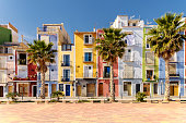 Colorful beach homes in Villajoyosa, a charming Mediterranean village in Alicante, Southern Spain