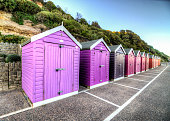 Colorful beach huts at Bournemouth Beach, United Kingdom.