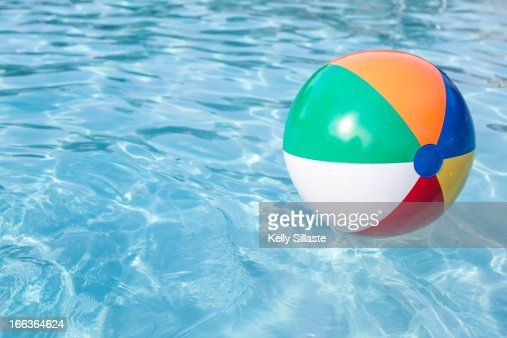 Pool Water With Beach Ball beach ball in pool stock photo | getty images
