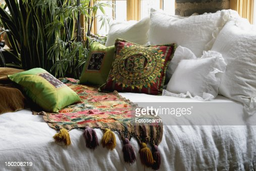 Throw Pillows On The Bed Song : Colorful Bed Runner And Throw Pillows On Bed Stock Photo Getty Images