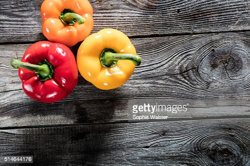 colorful bell peppers on authentic old wood copy space : Stock Photo