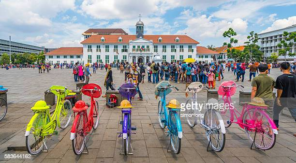 Colorful bicycle parking in front of old building, Jakarta