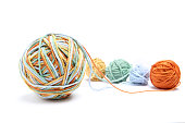 Different color (orange, yellow, green, blue) thread mix.