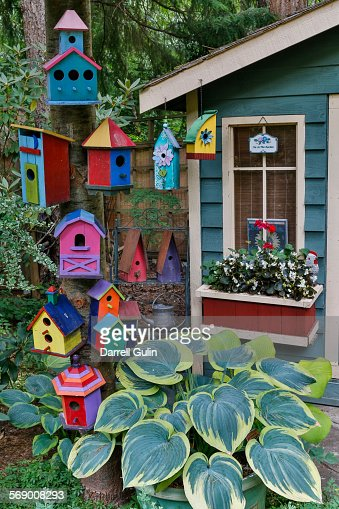Colorful birdhouses and shed