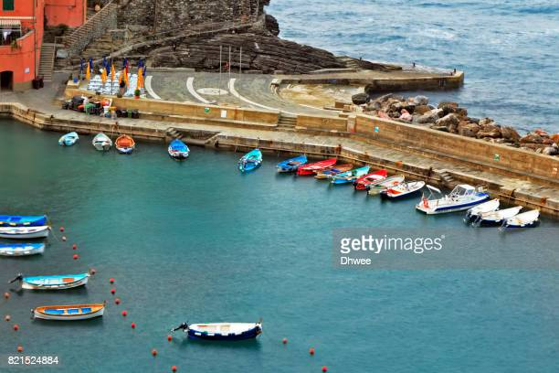 Colorful Boats Moored On At Vernazza Harbor. Cinque Terre Italy.