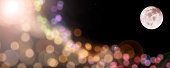 Colorful Bokeh from Full Moon Party at night time.Image of moon furnished by NASA.