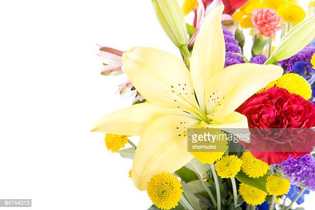 A colorful bouquet of yellow, red and purple flowers