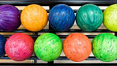 Colorful bowling balls in return machine