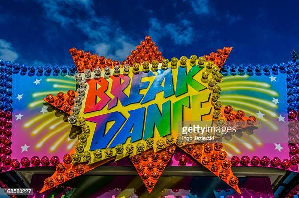 Colorful 'Break Dance' sign on a fun fair