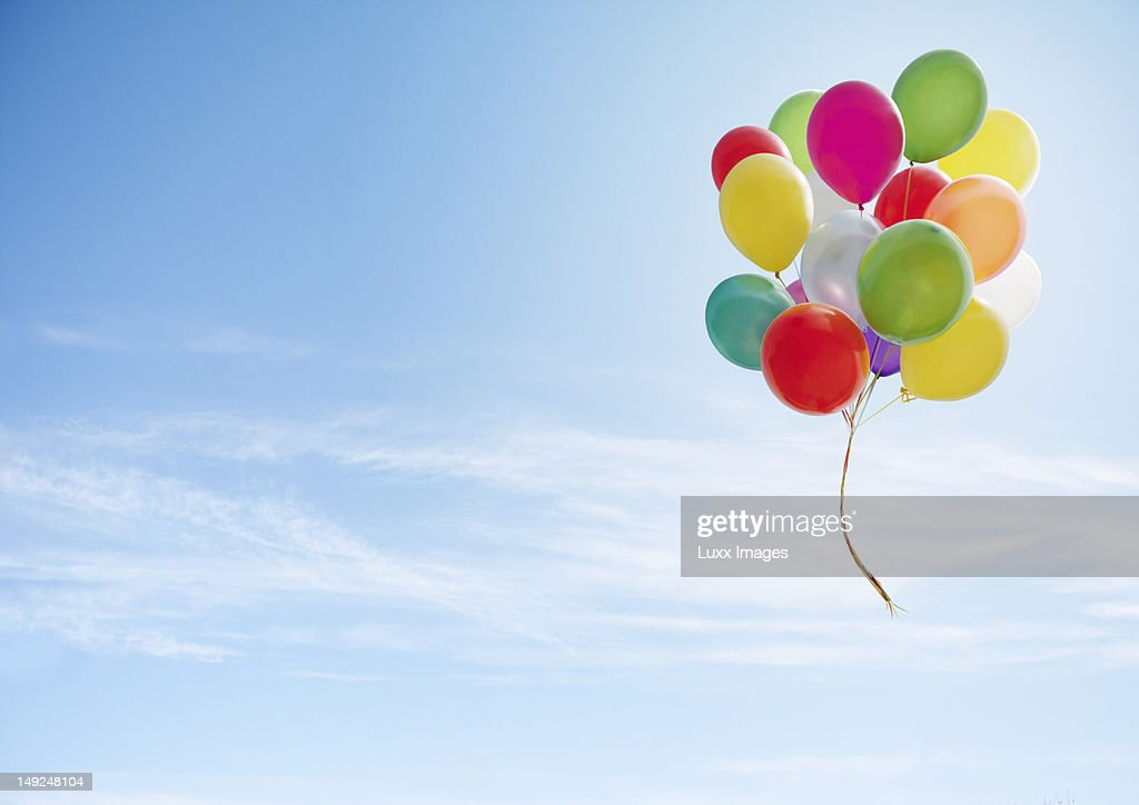 Colorful bunch of balloons floating in the sky