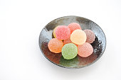colorful candies jelly beans isolated on  a plate on white background
