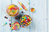 Colorful candies on wooden table background. Top view