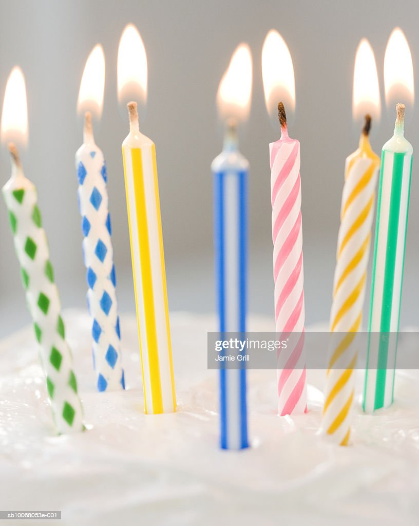 Colorful candles on cake, close-up : Stock Photo