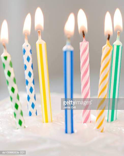 Colorful candles on cake, close-up